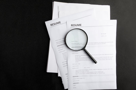 Wanted new employees.Free vacancy concept.Top view of stack of resume  on black background