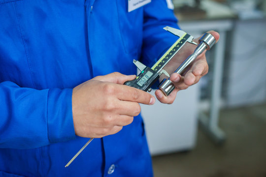 Quality Specialist Hands with measuring devices