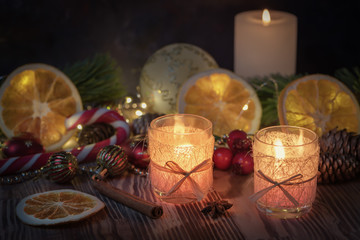 Christmas decorated Burning candles on wooden rustic background with christmas decoration