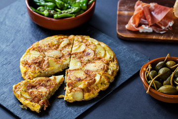 Authentic Spanish tapas with padron peppers and traditional tortilla