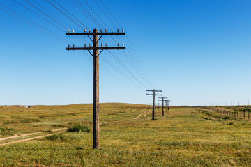 overhead line on wooden supports in the Mongolian steppe, Bayan, Mongolia