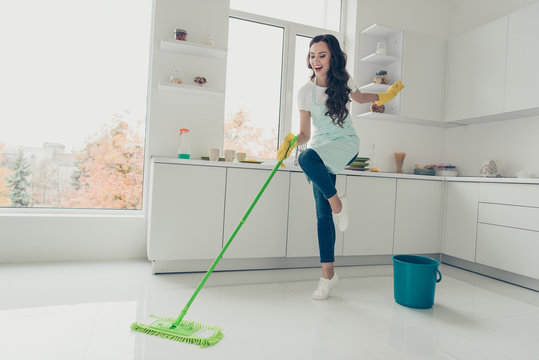 Full length body size side profile photo beautiful cheerful hardworking duties she her lady house love clean dancing singing wear jeans denim casual t-shirt covered cute apron bright light kitchen