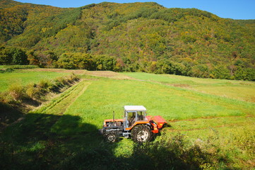 Tractor Mowing harvest Grass