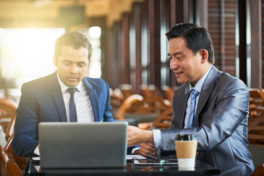 Businessmen working with laptop