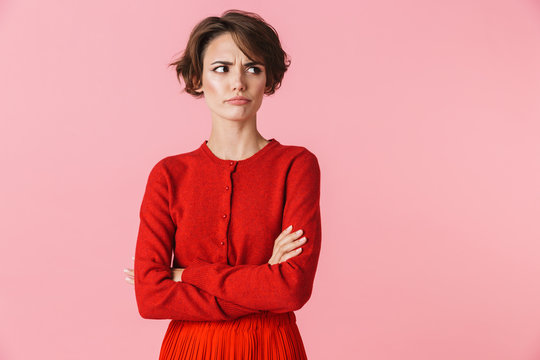 Portrait of a beautiful young woman wearing red clothes
