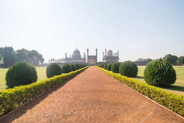 long path through the park to an Indian temple with arched domes and minarets