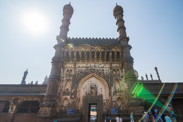 The main entrance to the Indian temple with arches domes and minarets
