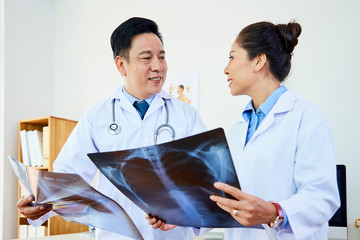 Radiologists examining x-ray images