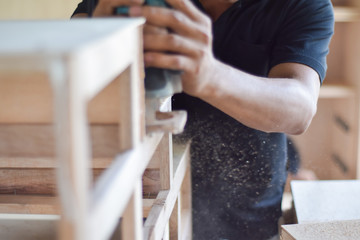 Carpenter working with planed wooden