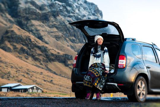 Female traveler enjoying Iceland view from the car