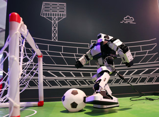 A robot kicks a soccer ball inside a Huawei booth at the Mobile World Congress in Barcelona
