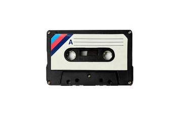 Audio retro vintage cassete tape isolated on white 80s style