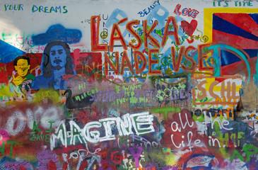 Fotobehang Graffiti collage PRAGUE, CZECH REPUBLIC - OCTOBER 12, 2018: Detail of John Lennon Peace Wall created in 1980.