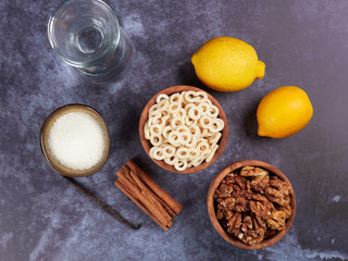 Ingredients for Romanian mucenici or macinici: figure eight pasta, boiled in water with sugar, cinnamon and crushed nuts. Traditional dessert for the Christian feast of the 40 Martyrs of Sebaste