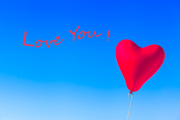 Love Greeting Balloon Image Card Motif / Flying heart shaped red helium balloon tied by rope at blue sky background and wavy textual message - LOVE YOU!
