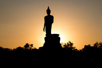 Buddha image and sunset light