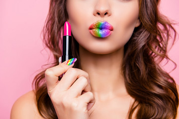 Cropped close-up shot portrait of nice gorgeous glamorous charming lady with amazing colorful tube pink pomade lips rainbow isolated over pink pastel background