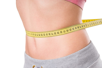 sport, fitness and diet concept, trained belly with measuring tape, health