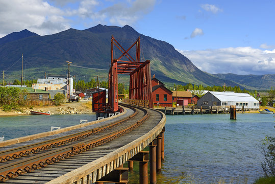 The Iron Rail Bridge of Carcross. Carcross is community in Yukon, Canada, on Bennett Lake and Nares Lake. Carcross is also on the White Pass and Yukon Route railway.