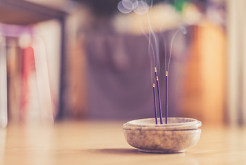 Smoking and smelling joss sticks at home, feng shui; Copy space