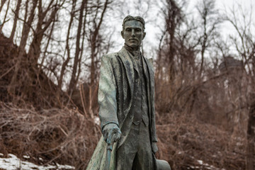 Niagara Falls CANADA - February 23, 2019: Nikola Tesla Sculpture in Queen Victoria Park in Niagara Falls, Canada. The monument was designed by sculptor Les Drysdale and opened in 2006.