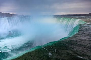 Niagara Falls CANADA - February 23, 2019: Winter frozen idyll at Horseshoe Falls, the Canadian side of Niagara Falls, view showing as well as the upper Niagara River