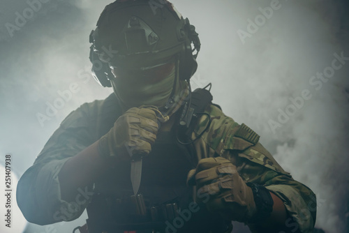 Spec ops police officer in black uniform on a studio background
