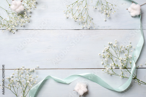 Spring background  White rustic flowers on blue wooden table