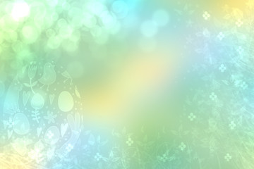 Happy easter background. Abstract blue yellow background texture with spring flowers and a colorful easter egg and a bright blue spring backdrop. Space for your design. Beautiful texture.