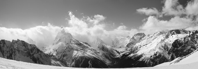 Fototapete - Panorama of snowy mountain peaks in sunlight clouds