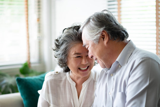 Asian senior couple in love laughing.