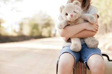 Little Girl with Ragged Teddybear and Suitcase - Poverty, Homelessness, Runaway Child