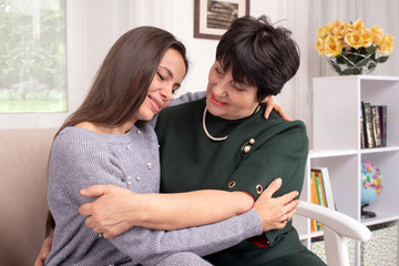 An adult daughter and her mother spending time together at home