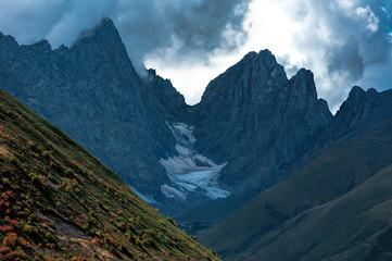 Sharp Roshkakhori mountain peaks in the clouds