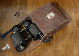 Old military binoculars in leather case