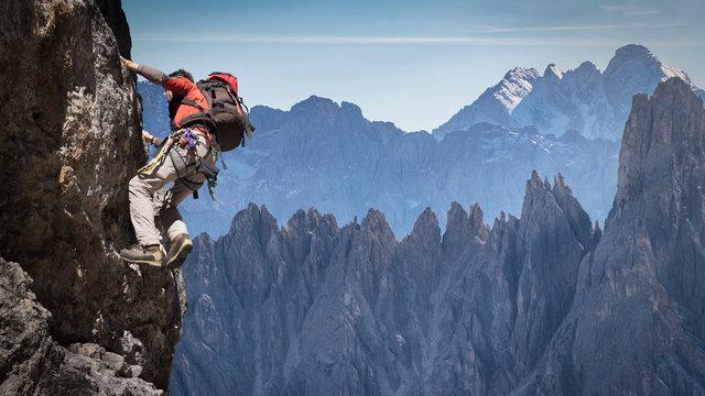 Man rock climbing in Dolomites, Italy