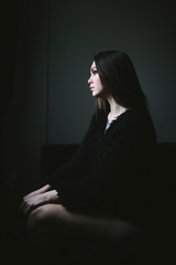 Young woman in black coat