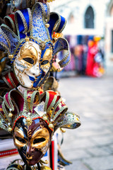 Traditional venetian mask in store on street, Venice Italy.