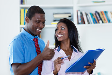 African american business man complimenting female trainee