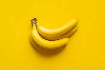 a bunch of bananas on yellow background isolated copy space design mockup b Wall mural