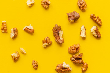 peeled walnut on yellow background isolated text design