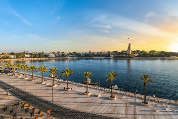 The Italian Sailor Monument, promenade and bay as the sun sets in the seaside port city of Brindisi Italy in the Southern region of Puglia.