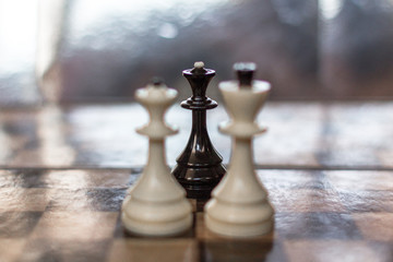 Game of chess. Board game on logic. Chess pieces as symbols. King and queen. Strategy and tactics. Power struggle Relationship metaphor. Third wheel. Treason in a relationship. Threat to love.