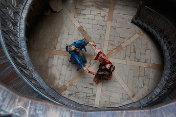 Middle eastern Women dancing in the middle of old wooden stairs