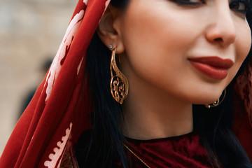 Beautiful middle eastern women wearing traditional dress, posing outdoors