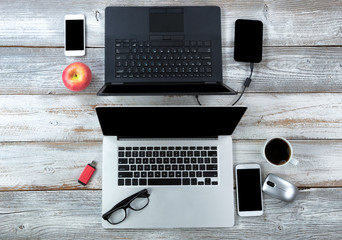 Technology on white desktop for business or education use with coffee and apple