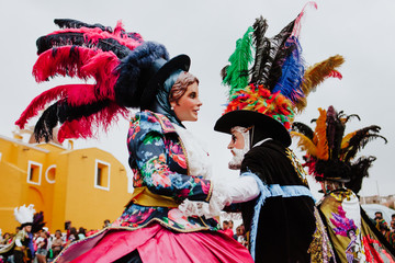 Huehues Mexico, mexican Carnival scene, dancer wearing a traditional mexican folk costume and mask rich in color