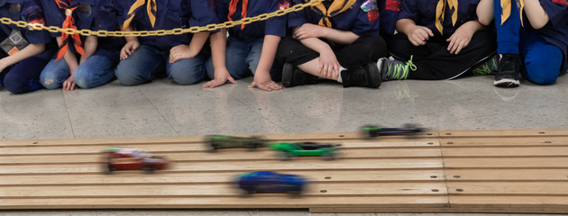 Boys watching wooden pinewood car race