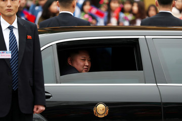 North Korea's leader Kim Jong Un sits in his vehicle after arriving at the Dong Dang railway station