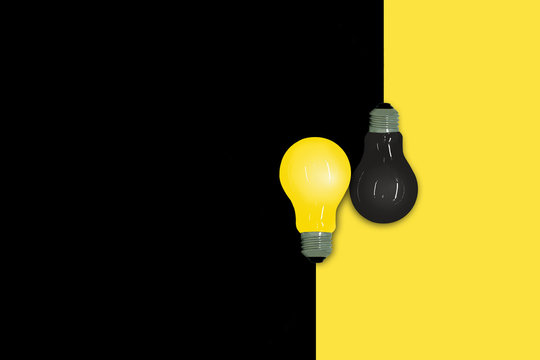 Business Creative and Idea Concept : Yellow and Black light bulb put on half yellow and black background.